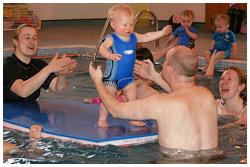 baby swimming balancing-on-big-float